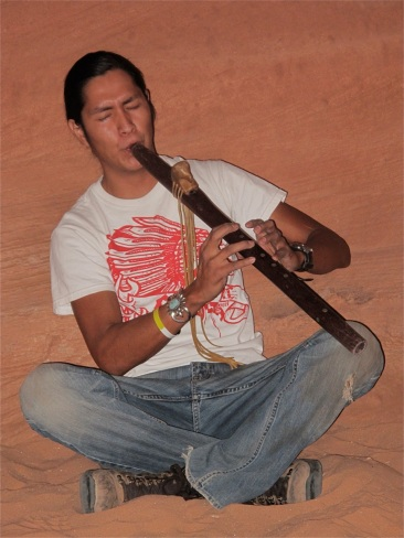 Listening to a flute in an Arizona slot canyon. ©Hilary Nangle