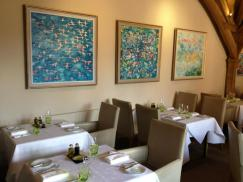 The Estate Grill at Great Fosters, with Flamingo collection by Artist Jeremy Houghton. Great Fosters photo.